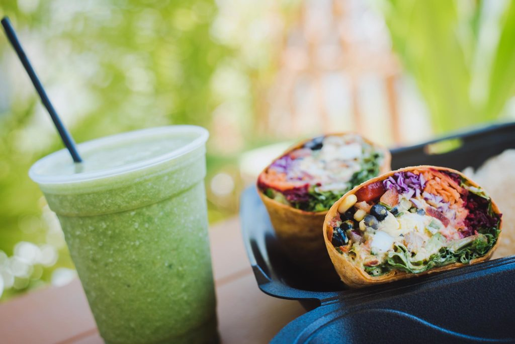 Two of Crave Food Truck's specialties: a green smoothie and wrap.